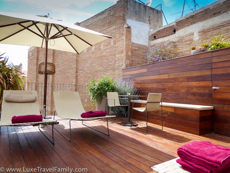 chairs on the teak rooftop deck at the Mercer Barcelona