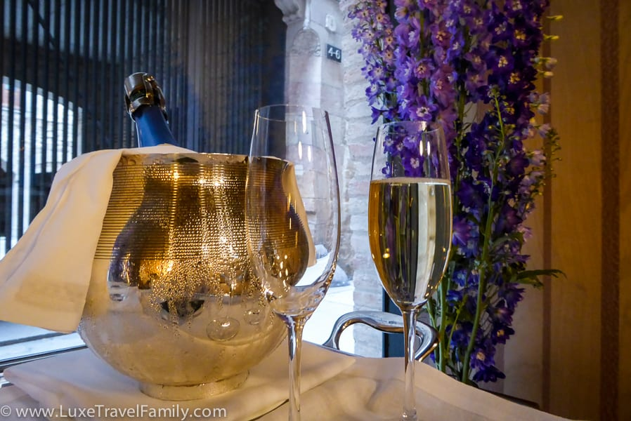 A bottle of cava and two glasses in the reception at the Mercer Hotel Barcelona.