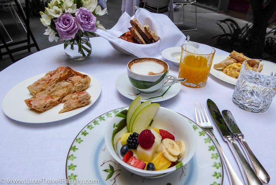 Fruit bowl, latte, pastries, orange juice and eggs Mercer Barcelona