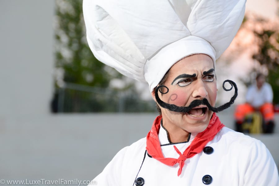 Cirque du Soleil actor in chefs hat with big handlebar moustache at Expo 2015