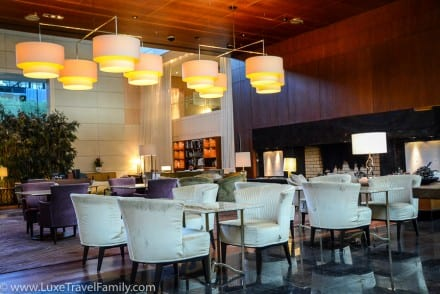 Park Hyatt Zurich Lobby Lounge chairs, tables and large fireplace