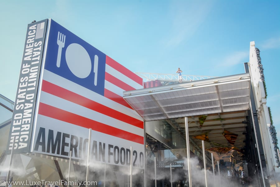 The USA Pavilion at Expo 2015 displays a massive American flag with a plate, knife and fork instead of stars