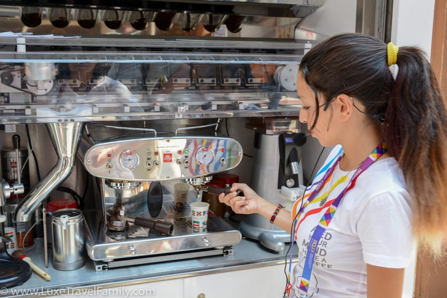A barista making an illy espresso at Expo 2015 Milan