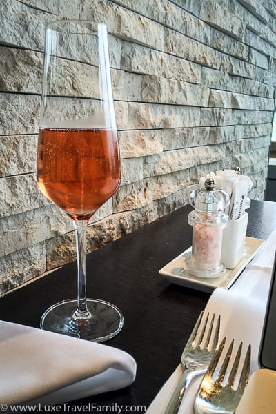 A glass of rose champagne in the Swiss First Class Lounge