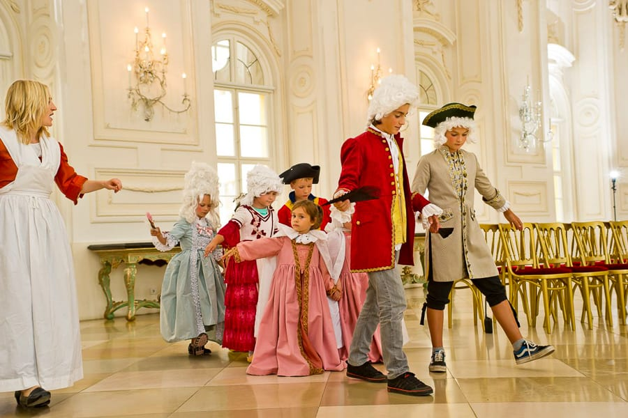 Things to do in Vienna with kids costume Schonbrunn Palace.