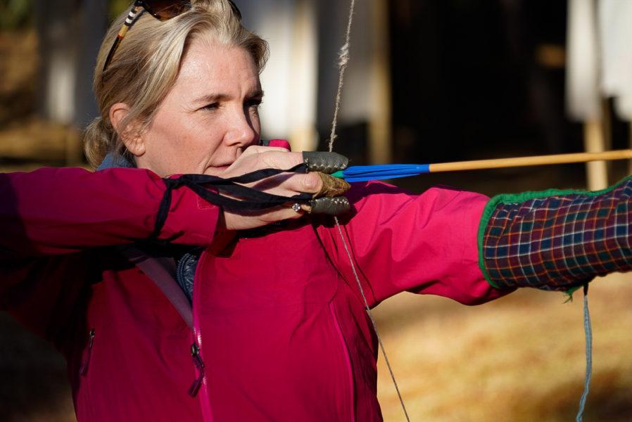 Woman playing archery Bhutan